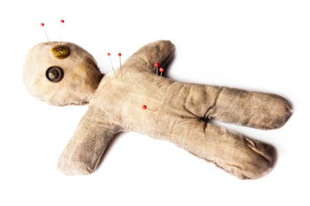 to curse: photo of creepy voodoo doll isolated on white
