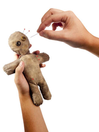 wizardry: photo of hands holding creepy voodoo doll isolated on white Stock Photo