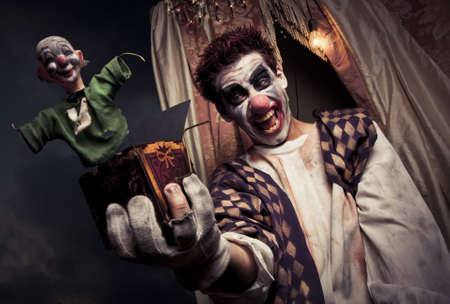 scary clown holding a Jack-in-the-box toy
