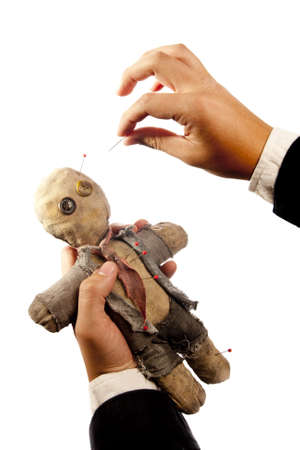 businessman making harm to coworker via voodoo on white photo