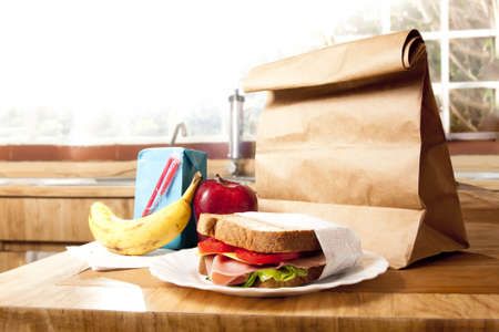 school bag: delicious and healthy school lunch with paper bag Stock Photo