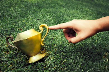 witchery: photo of midas touch concept with hand and vase