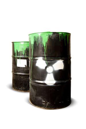 hazardous waste: toxic drum barrels spilled their hazardous content contaminating the earth