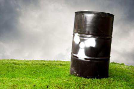 pollution concept using a drum barrel with hazard logo photo