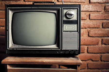 retro: retro tv turned of against brick wall