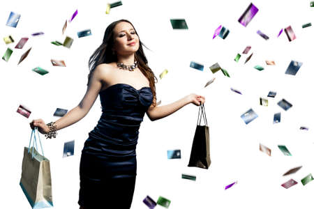 young and beautiful woman with shopping bags and raining credit cards photo