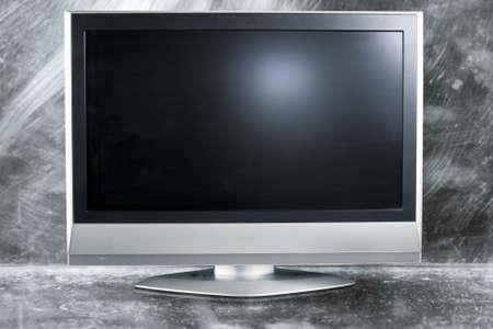 flat screen tv on metal background