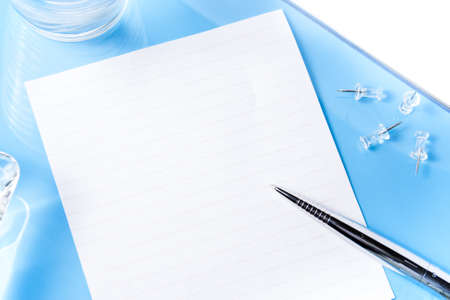 top: Top view on office blue desk with objects  Stock Photo