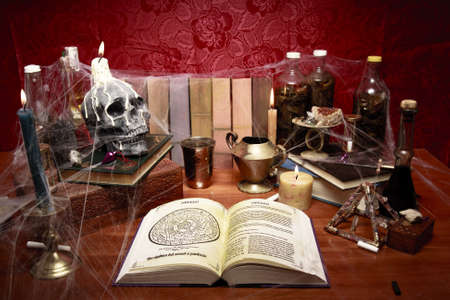 old desk: high contrast photo of a witchs table Stock Photo