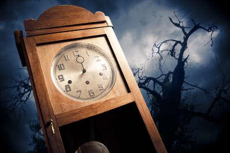 dark antique clock at Halloween night