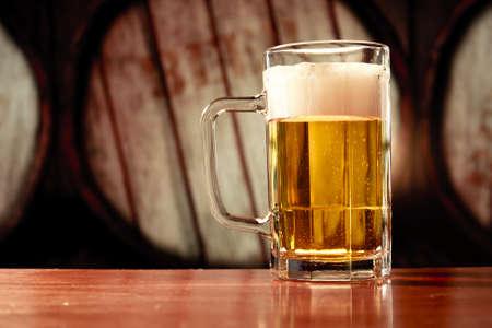 beer production: beer mug on vintage background