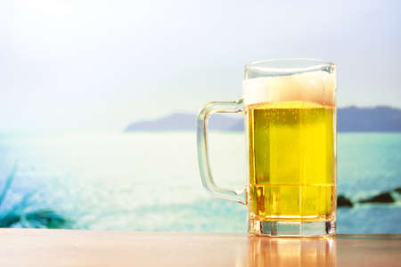 beer mug on blue sky photo