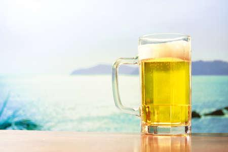 beer production: beer mug on blue sky