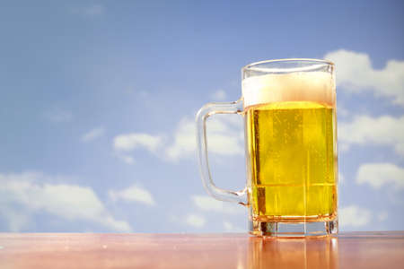 beer mug on blue sky Stock Photo - 11589116