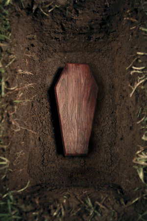 coffin: photo of wooden coffin at a graveyard