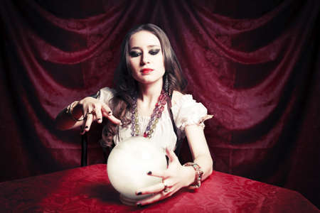 seance: fortuneteller with crystal ball Stock Photo