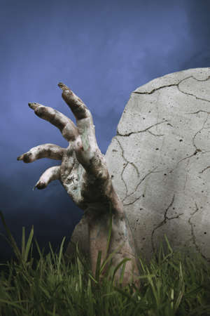 hand: zombie hand coming out of his grave