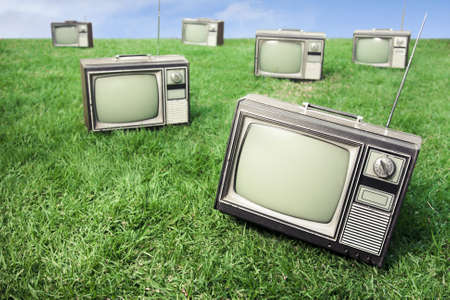 retro tv: field of grass with tvs Stock Photo
