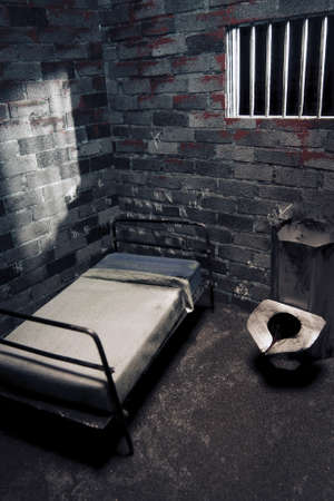 cramped: dark prison cell at night