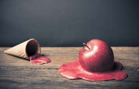 no mistake: conceptual photo of a melting apple