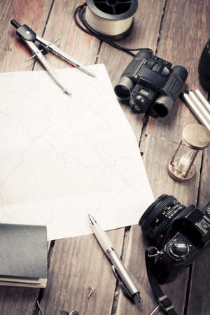 fishingpole: table with fishing and photography items Stock Photo