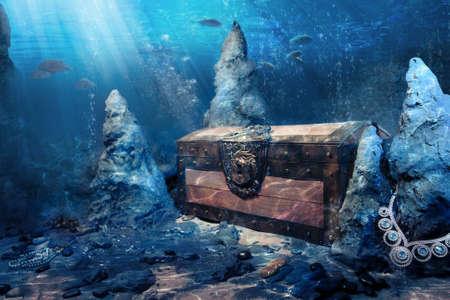 treasure hunt: photo of wooden treasure chest submerged underwater with light rays Stock Photo