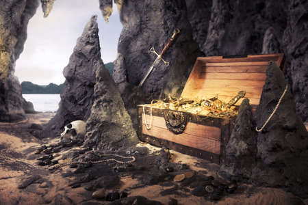 photo of open treasure chest with shinny gold in a cave photo