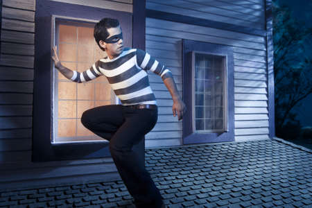 dangerous burglar about to enter house photo