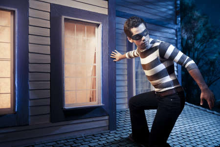 stealing: dangerous burglar about to enter house