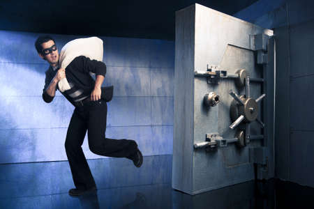 heist: thief running out of a bank vault, low-key photo
