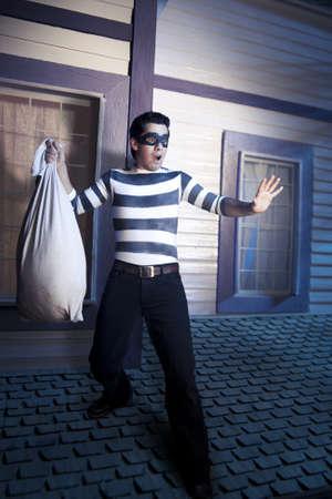 to creep: dangerous burglar about to enter house