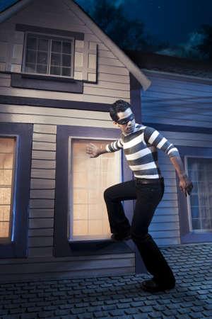 horrifying: dangerous burglar about to enter house
