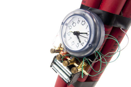 detonating: timebomb made of dynamite isolated on white
