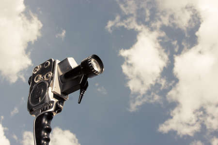 filmmaker: photo of an 8mm film camera outdoors Stock Photo
