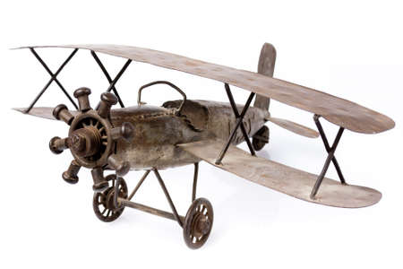 old metal airplane toy isolated on white photo