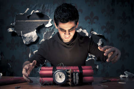 timebomb: high contrast image of a terrorist making a timebomb