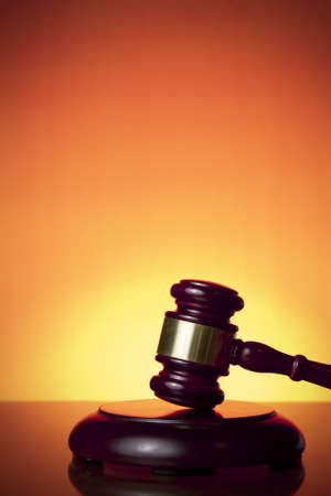judge gavel on orange background photo