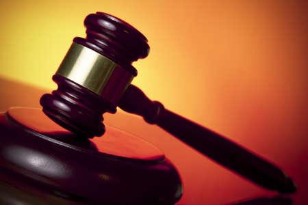 judge gavel on orange background photo