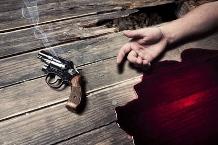 weapons: gun with smoke and blood on the floor, suicide concept Stock Photo