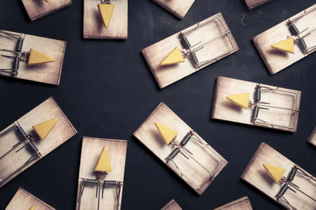 mouse traps with cheese pointing towards an empty space Stock Photo - 12792892