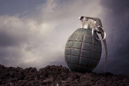granade: green grenade resting on a battlefield