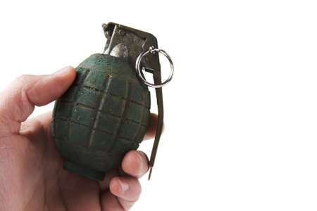 hand holding a grenade isolated on white photo