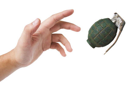 detonate: hand throwing a grenade isolated on white Stock Photo