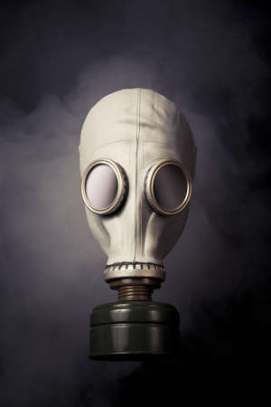 fetishes: high contrast image of a gas mask and smoke Stock Photo
