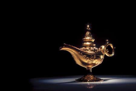 three wishes: aladdin magic lamp on black Stock Photo