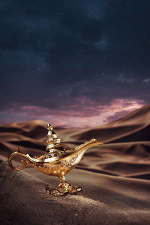 three wishes: Aladdin magic lamp on a desert