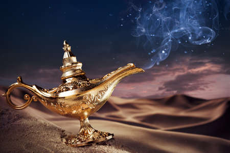 three wishes: Aladdin magic lamp on a desert with smoke