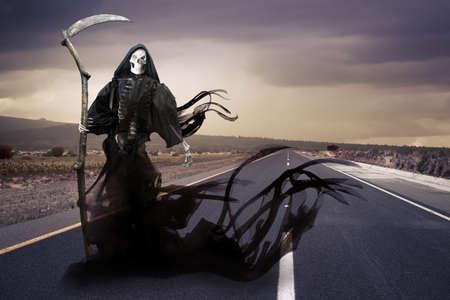 Grim reaper on a road