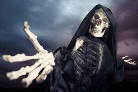 spooky skull: Grim reaper on a dark background