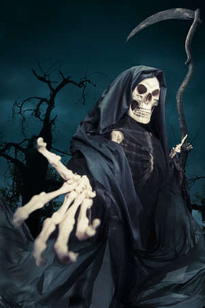 life and death: Grim reaper on a dark background